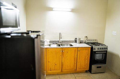 A kitchen or kitchenette at Connie's Comfort Suites