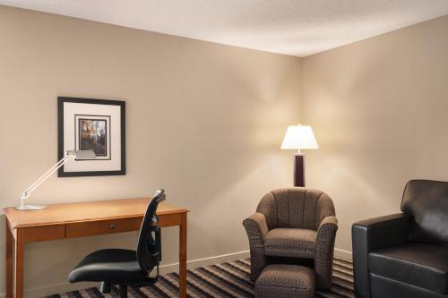 A seating area at Royal Hotel West Edmonton, Trademark Collection by Wyndham