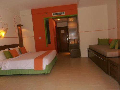 A bed or beds in a room at Ibis Styles Bali Legian