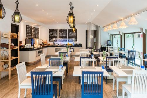 Een restaurant of ander eetgelegenheid bij Hotel San Sebastián Orly, Affiliated by Meliá