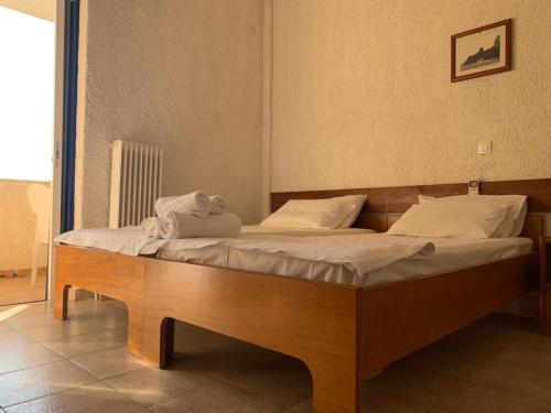 A bed or beds in a room at Sariza Spring Hotel