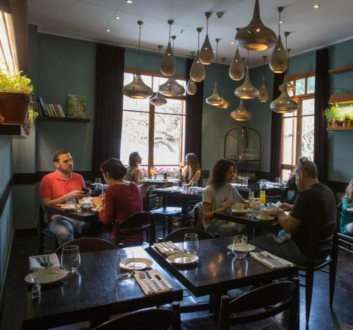 A restaurant or other place to eat at The Rothschild Hotel - Tel Aviv's Finest