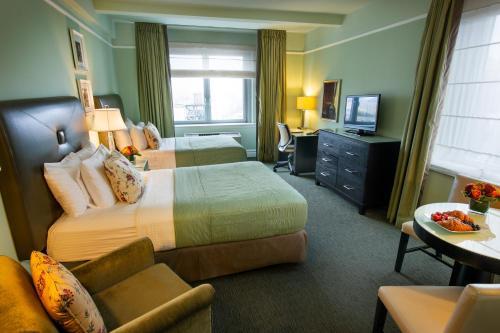 Un ou plusieurs lits dans un hébergement de l'établissement Hotel Beacon