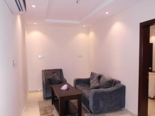Uma área de estar em Rafahiat Jeddah Hotel Suites 2