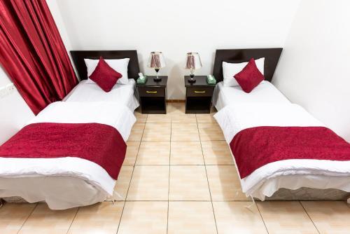 Cama ou camas em um quarto em Al Eairy Apartments - Al Madinah 4