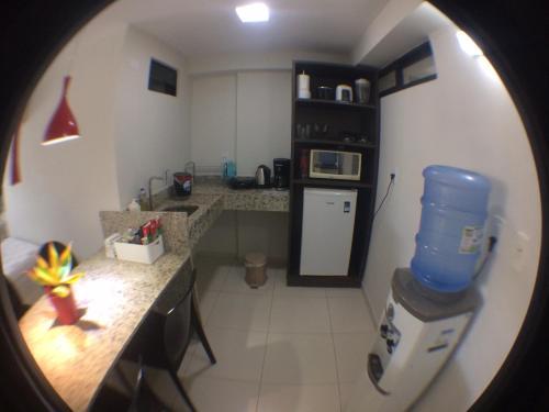 A kitchen or kitchenette at Tabatinga Residence Apart Hotel