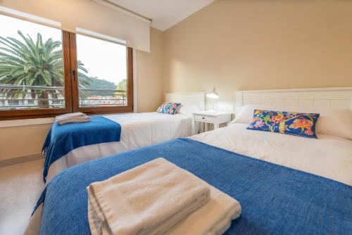 Uma cama ou camas num quarto em Nuevo apartamento en Isla de la Toja