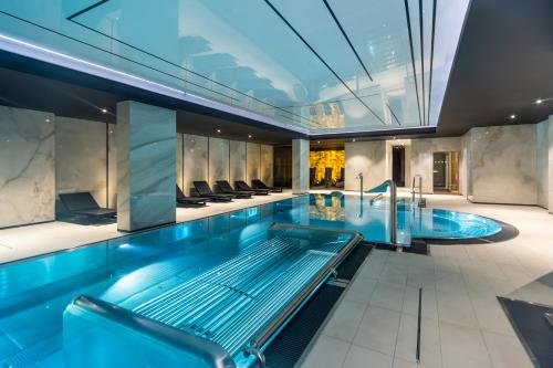 The swimming pool at or close to Radisson Hotel & Suites, Gdansk