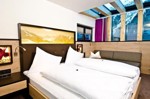 A bed or beds in a room at Astellina hotel-apart