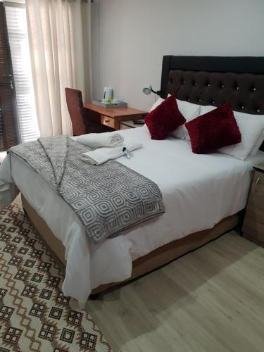 A bed or beds in a room at Vaticious