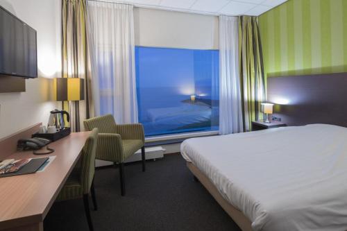 Een bed of bedden in een kamer bij Hotel Lands End
