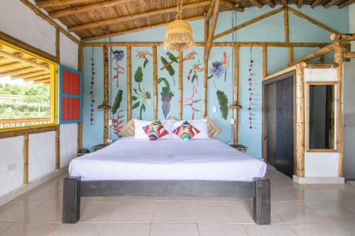 A bed or beds in a room at Selina Quindio