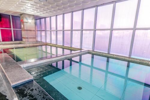 The swimming pool at or near The Blue Sky Hotel and Tower
