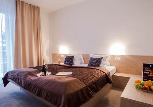 Posteľ alebo postele v izbe v ubytovaní ELITE hotel & restaurant Nová Dubnica