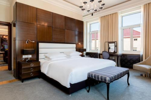 A bed or beds in a room at Grand Hotel Kempinski Vilnius