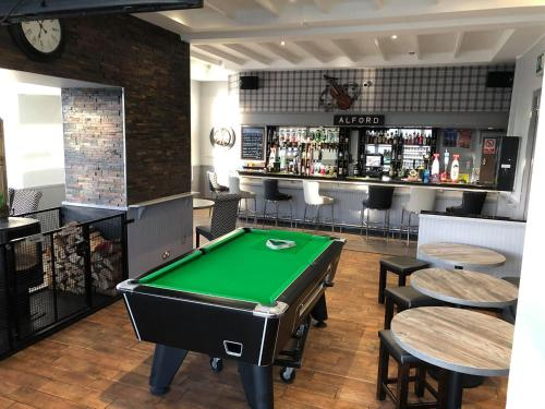 A pool table at Haughton Arms Hotel