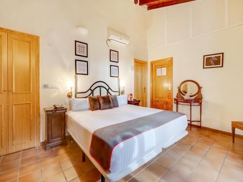Ein Bett oder Betten in einem Zimmer der Unterkunft OYO Hotel Torre San Juan