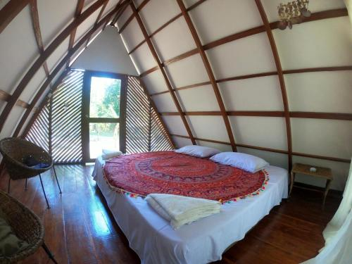 A bed or beds in a room at Hotel Jasayma Parque Tayrona