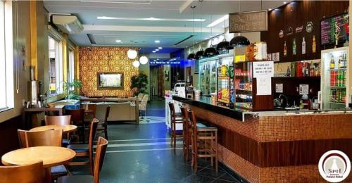 O lounge ou bar de Santuário Palace Hotel