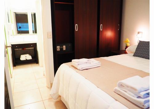 Una cama o camas en una habitación de Umbral del Aconcagua