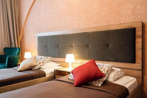 Кровать или кровати в номере House City