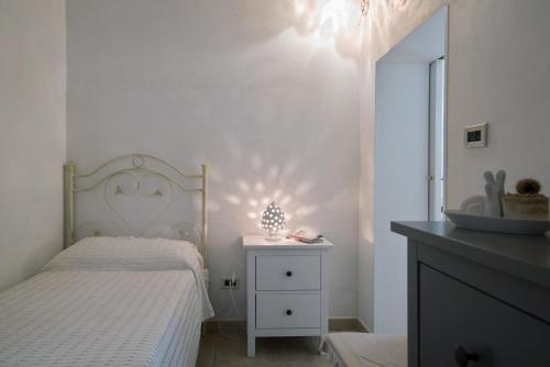 Ein Bett oder Betten in einem Zimmer der Unterkunft White House Flats & Studios