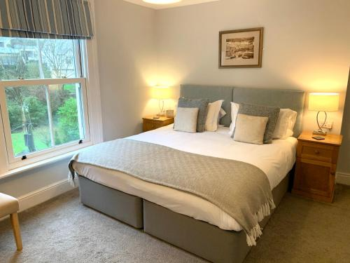 A bed or beds in a room at The Claremont Hotel-Adult Only
