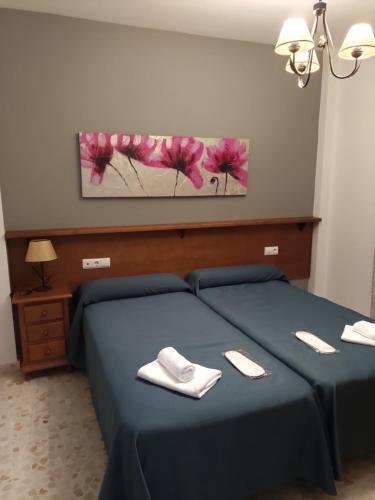 Cama o camas de una habitación en Apartamentos Casa Sardina
