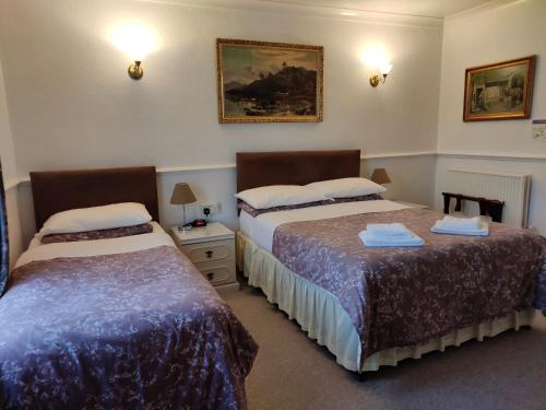 A bed or beds in a room at Arundel Park Hotel