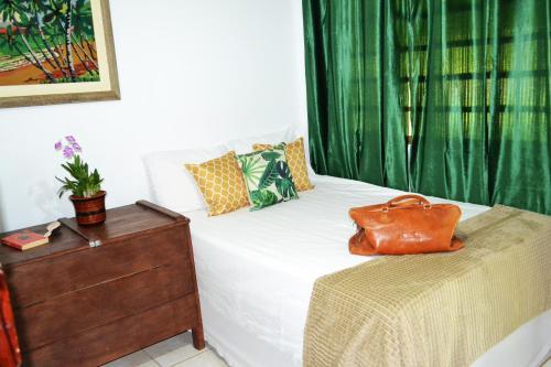 A bed or beds in a room at Casa de Temporada em Bonito-MS