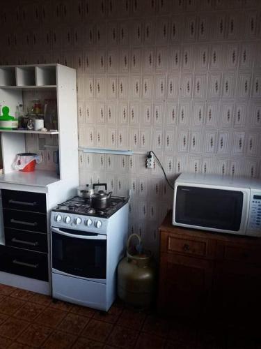 A kitchen or kitchenette at Pensão Bela Vista
