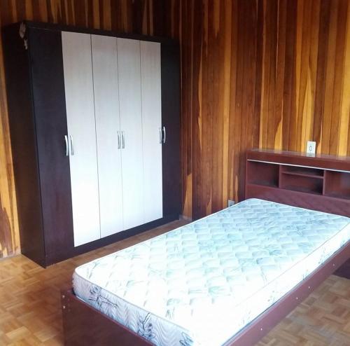 A bed or beds in a room at Pensão Bela Vista