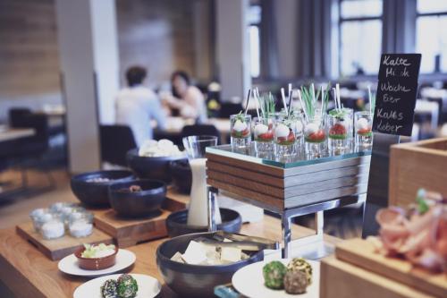 Ein Restaurant oder anderes Speiselokal in der Unterkunft Seehotel Bellevue