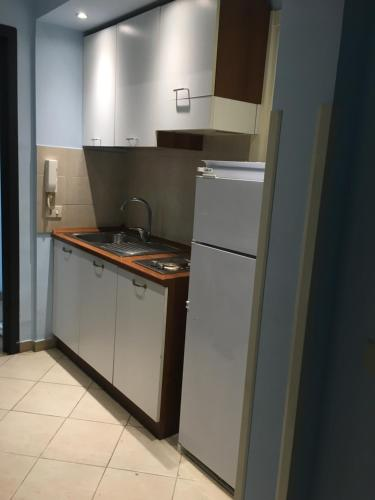 A kitchen or kitchenette at Residence Lodi