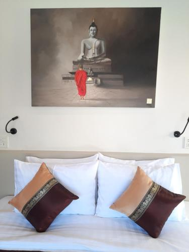 Ein Bett oder Betten in einem Zimmer der Unterkunft Baan Sawan Samui Resort