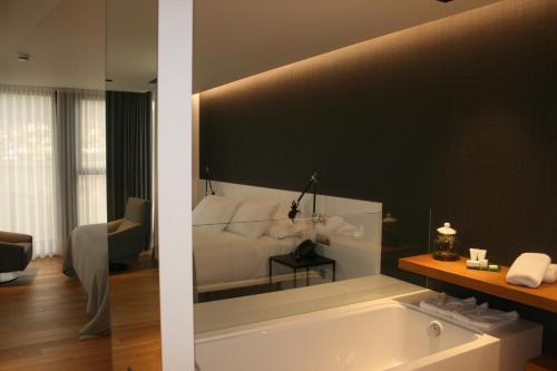 Un baño de Viveiro Urban Hotel