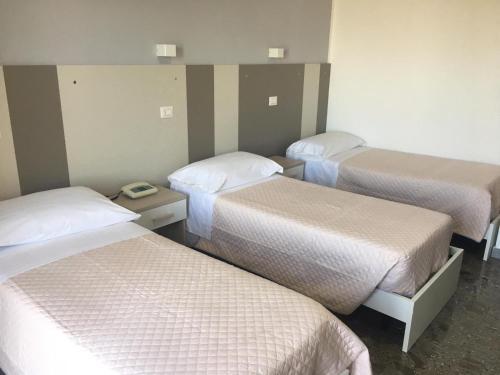 Letto o letti in una camera di Piccolo Hotel