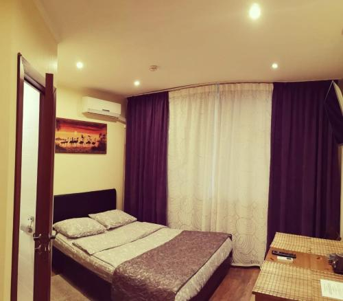 Кровать или кровати в номере Отель Александрия