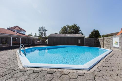 The swimming pool at or near Strandhotel Dennenbos