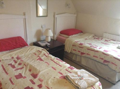 A bed or beds in a room at Park House Guest House