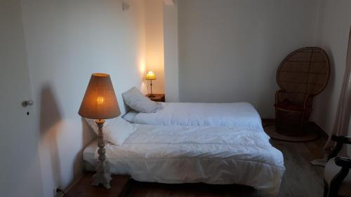 A bed or beds in a room at Domaine du Garret