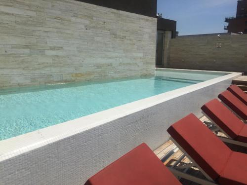 The swimming pool at or close to Suite Deluxe