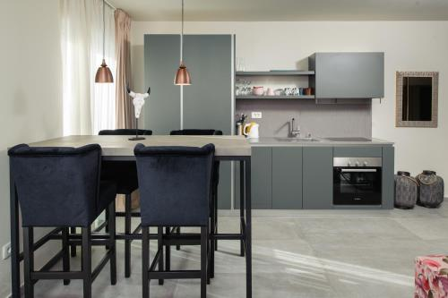 A kitchen or kitchenette at Boban Luxury Suites