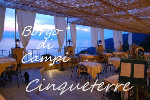 A restaurant or other place to eat at Il Borgo Di Campi
