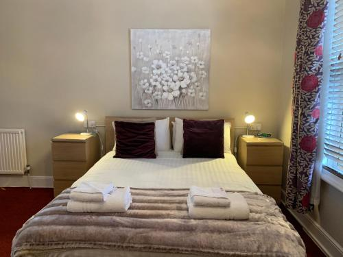A bed or beds in a room at Brayford Guest House
