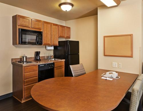 A kitchen or kitchenette at Candlewood Suites St. Robert, an IHG Hotel