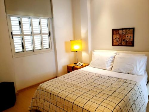 A bed or beds in a room at South Beach Copacabana