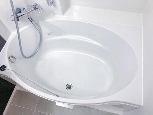 A bathroom at HOTEL UNIZO Nagoya Ekimae