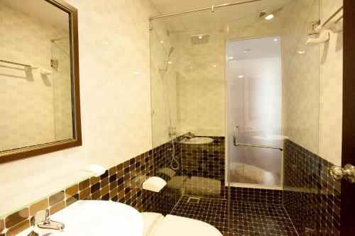 A bathroom at Galaxy Apartment