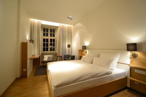 Ein Bett oder Betten in einem Zimmer der Unterkunft Bildungs- und Tagungshaus Liborianum